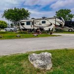 photo of rv site and 5th wheel rv
