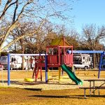 Photo of a playground with RV sites in background